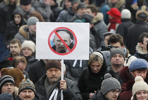 Opposition supporters gather before a protest demanding fair elections in central Moscow
