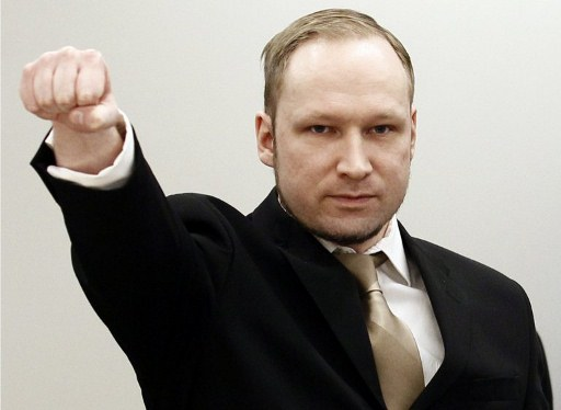TOPSHOTS  Rightwing extremist Anders Behring Breivik, who killed 77 people in twin attacks in Norway last year, makes a farright salute as he enters the Oslo district courtroom at the opening of his trial on April 16, 2012. Breivik told the Court that he did not recognise its legitimacy. Since Breivik has already confessed to the deadliest attacks in post-war Norway, the main line of questioning will revolve around whether he is criminally sane and accountable for his actions, which will determine if he is to be sentenced to prison or a closed psychiatric ward.   AFP PHOTO / POOL / Hakon Mosvold Larsen
