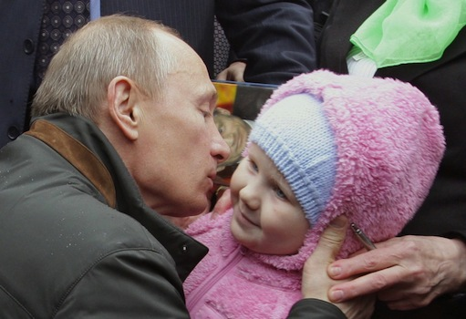 A picture taken on May 29, 2010 shows Russian Prime Minister Vladimir Putin as he kisses a baby during his visit to Nevskaya Dubrowka dormitory outside St. Petersburg. AFP PHOTO / RIA NOVOSTI / POOL / ALEXEY DRUZHININ (Photo credit should read ALEXEY DRUZHININ/AFP/Getty Images)