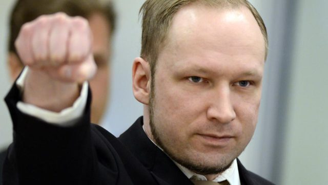 Rightwing extremist Anders Behring Breivik, who killed 77 people in twin attacks in Norway last year, makes a farright salute as he enters the Oslo district courtroom at the opening of his trial on April 16, 2012. Breivik told the Court that he did not recognise its legitimacy. Since Breivik has already confessed to the deadliest attacks in post-war Norway, the main line of questioning will revolve around whether he is criminally sane and accountable for his actions, which will determine if he is to be sentenced to prison or a closed psychiatric ward. AFP PHOTO / ODD ANDERSEN (Photo credit should read ODD ANDERSEN/AFP/Getty Images)